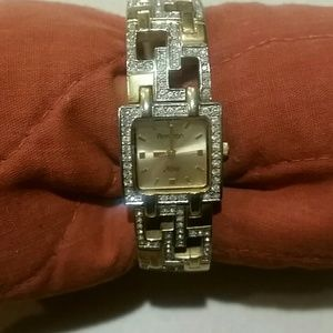 Womans watch gold tone w stones GUC